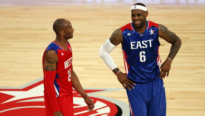 NBA All-Stars Kobe Bryant, left, and LeBron James, right, helped the ratings race.