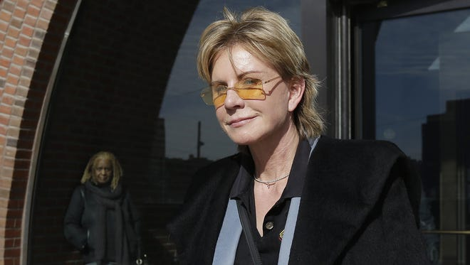 Author Patricia Cornwell leaves federal court in Boston, Feb. 7, 2013.