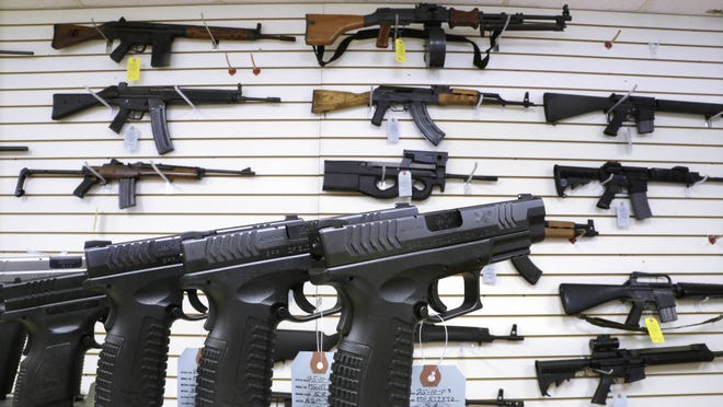 Assault weapons and handguns are for sale at Capitol City Arms Supply in Springfield, Ill.