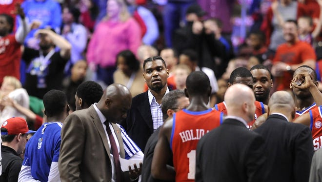 Philadelphia 76ers' Andrew Bynum, middle, keeps pushing back the timetable on his return from injury.
