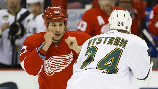 Detroit Red Wings right wing Jordin Tootoo takes on Dallas Stars left wing Eric Nystrom in one of his four fights this season.