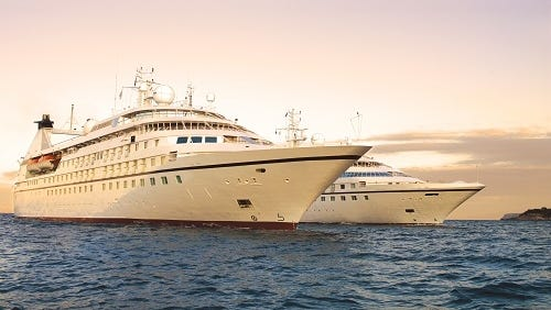 Two of three Seabourn Cruise Line vessels that are being acquired by the parent company of Windstar Cruises.