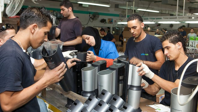 Jews, Palestinians and Arabs from East Jerusalem work side-by-side in the West Bank factory of SodaStream, the subject of a pro-Palestinian boycott.