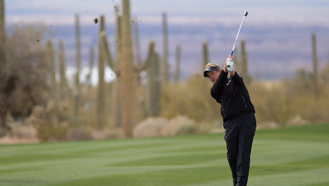 Cacti stand sentinel in the background as Luke Donald plays the Accenture Match Play Championship at Dove Mountain.