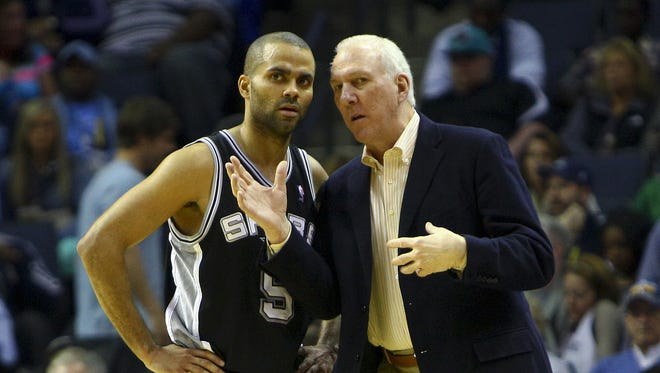 San Antonio Spurs coach Gregg Popovich, right, challenged point guard Tony Parker to take over the team.