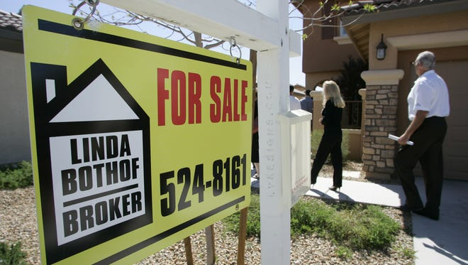 Potential buyers look over a home in Las Vegas, where one in five people moved locally during the recession.