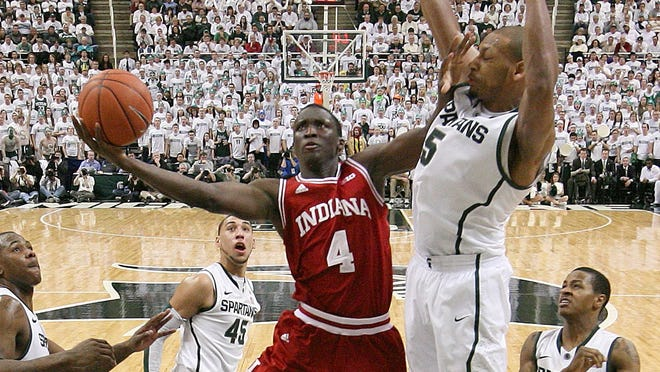Indiana guard Victor Oladipo (4) drives to the basket against Michigan State center Adreian Payne (5) during the second half of the Hoosiers' 72-68 win on Tuesday night.
