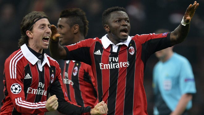 AC Milan midfielder of Sulley Ali Muntari, right, celebrates scoring against FC Barcelona at San Siro Stadium in Milan.