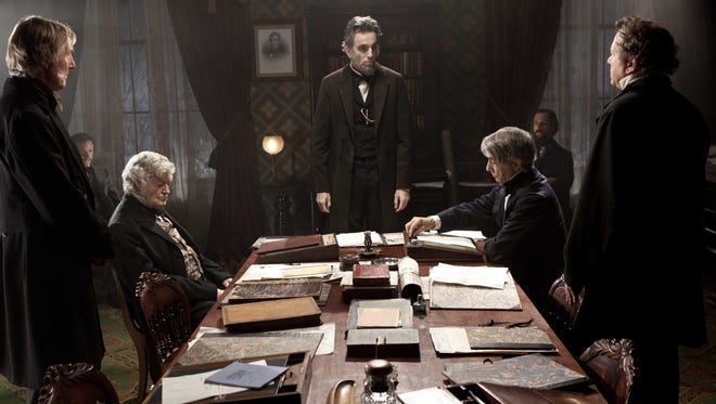 """Daniel Day-Lewis, center rear, portrays Abraham Lincoln in a scene from """"Lincoln"""" the film."""