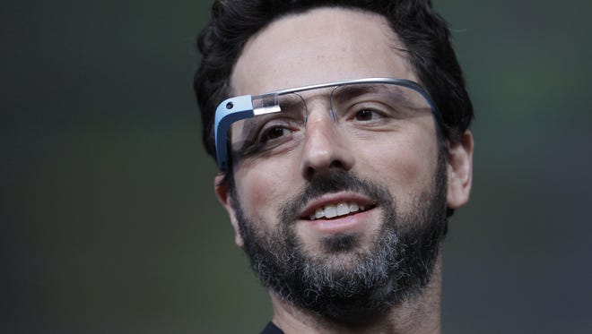 Google co-founder Sergey Brin demonstrates Google's new Glass, wearable Internet glasses, at the Google I/O conference in San Francisco last June.