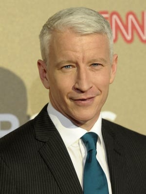 In this Dec. 2, 2012 file photo, reporter Anderson Cooper arrives at CNN Heroes at The Shrine Auditorium in Los Angeles.