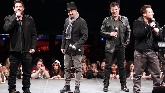 Jeff Timmons, left,  Justin Jeffre, Nick Lachey  and Drew Lachey of 98 Degrees perform during the announcement of The Package Tour in New York City.