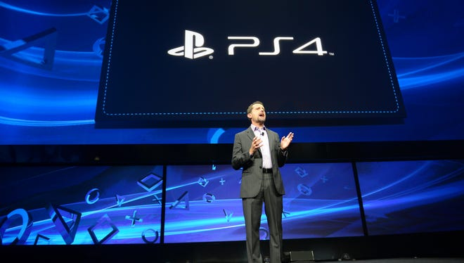 Sony's Andrew House, current president and Group CEO of Sony Computer Entertainment, introduces the PlayStation 4 at a news conference in New York.