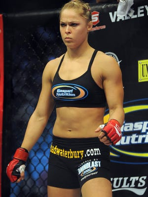 Ronda Rousey, shown here before an August 2012 bout against Sarah Kaufman (not pictured) that Rousey won in 54 seconds, can claim the UFC bantamweight crown with a win over Liz Carmouche on Saturday night in Anaheim, Calif.