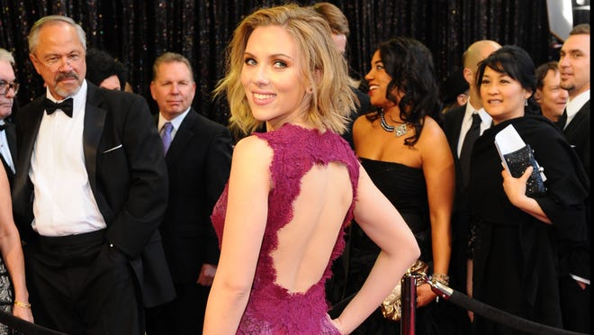 A little bleach and charmeuse, and bam! Scarlett Johansson's magenta gown with keyhole back from 2011 is ready for the racks at David's Bridal.