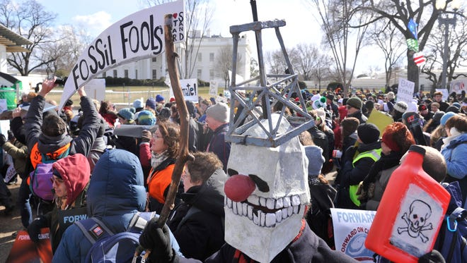 Demonstrators at a rally to boost support for measures to address climate change on Feb. 17 in Washington, D.C.