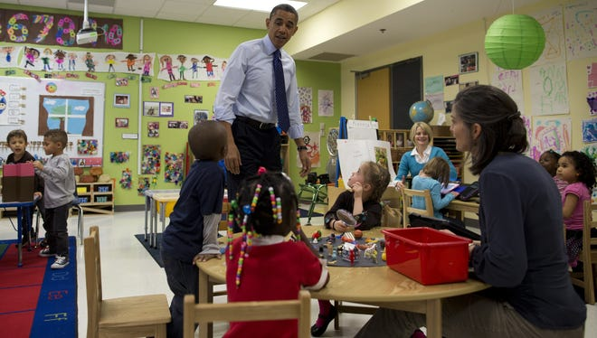 President Obama visits a preschool classroom  on Valentine's Day in Decatur, Ga.