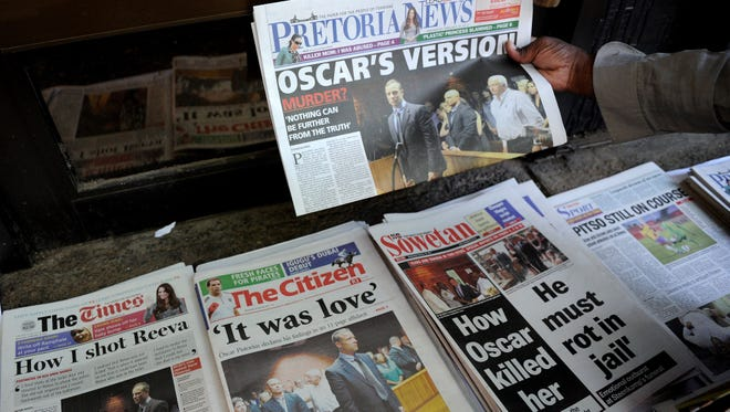 Front pages of South African newspapers featuring Olympic runner Oscar Pistorius' Feb. 19 court appearance on premeditated murder charges.