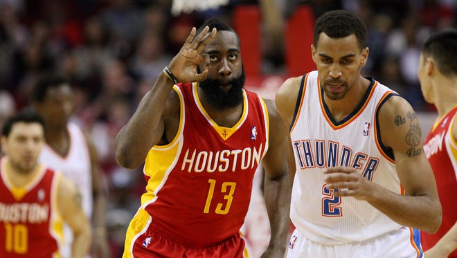 Rockets guard James Harden shows off his three-goggles next to former Thunder teammate Thabo Sefolosha during Wednesday's 122-119 win.