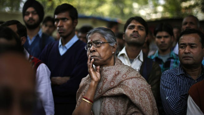 People listen to a speaker while they participate in a protest in New Delhi on Thursday against a new sexual violence law that activists say is inadequate.