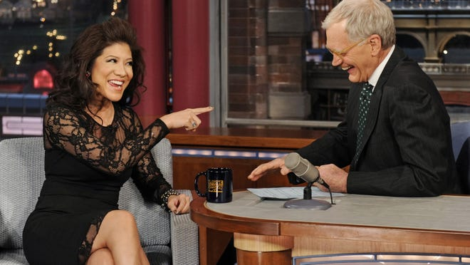 """Julie Chen, co-host of the CBS daytime talk show """"The Talk,"""" chats with David Letterman on the set of """"The Late Show With David Letterman"""" on  Dec. 13, 2012."""