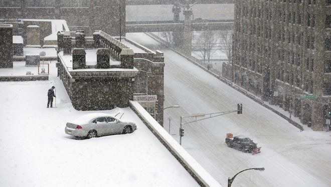 Steady snow falls Thursday in St. Louis. Blinding snow bombarded much of the nation's midsection.