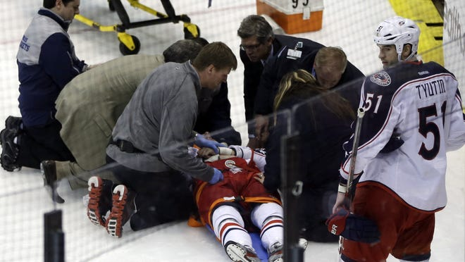 Team doctors and emergency personnel tend to Columbus Blue Jackets center Artem Anisimov, of Russia, during the second period of an NHL hockey game against the Detroit Red Wings in Detroit, Thursday, Feb. 21, 2013.