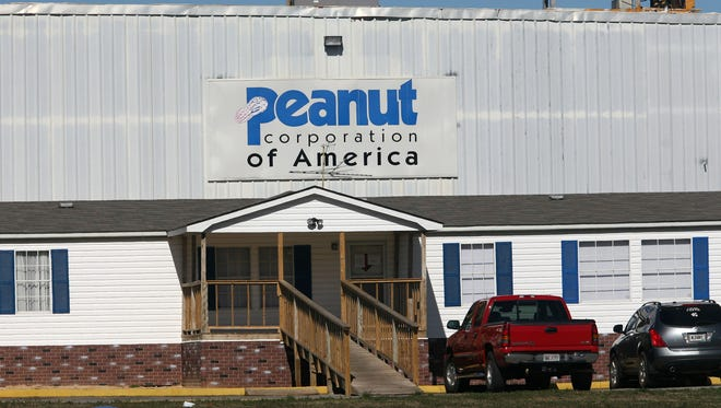 Four former officials of the Peanut Corporation of America were named in a 75-count indictment Thursday on charges related to salmonella-tainted peanuts and peanut products.