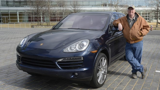 USA TODAY's James R. Healey with the new Porsche Cayenne Diesel.