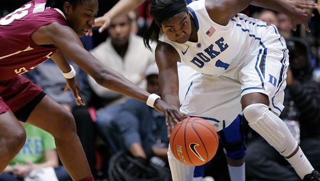 Florida State forward Natasha Howard reaches in against Duke center Elizabeth Williams during the first half. Williams scored 20 points as No. 4 Duke beat No. 20 FSU, 61-50.