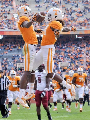 Tennessee Volunteers wide receiver Justin Hunter (11) celebrates with teammate Cordarrelle Patterson (84) after a touchdown against the Troy Trojans during the first half at Neyland Stadium.