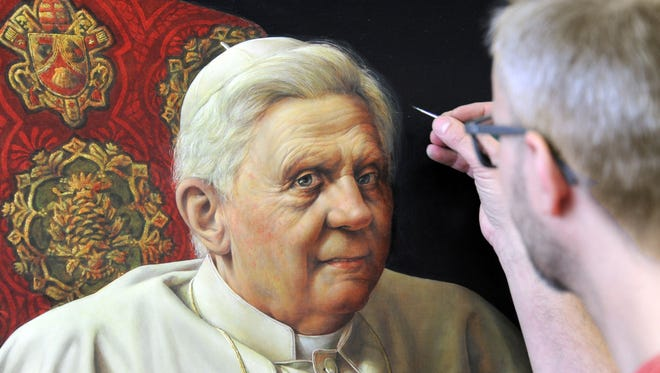 Artist Michael Triegel, known as 'Pope painter,' works on his second portrait of Pope Benedict XVI in his studio in Leipzig, Germany, Tuesday, Feb. 19, 2013. The one meter high and 72 centimeter wide portrait is a commissioned work for the German Embassy at the Holy See in Rome. It is supposed to be delivered as a loan to Rome on the pope's birthday on 16 April 2013.