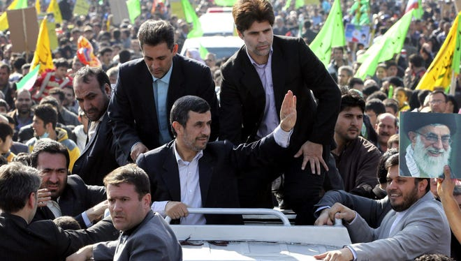 Iranian President Mahmoud Ahmadinejad waves during an annual rally commemorating the anniversary of the 1979 Islamic revolution  in Tehran on Feb. 10.