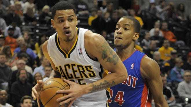 Indiana Pacers forward Gerald Green drives to the basket around Detroit Pistons guard Kim English in the second half in Indianapolis, Ind.