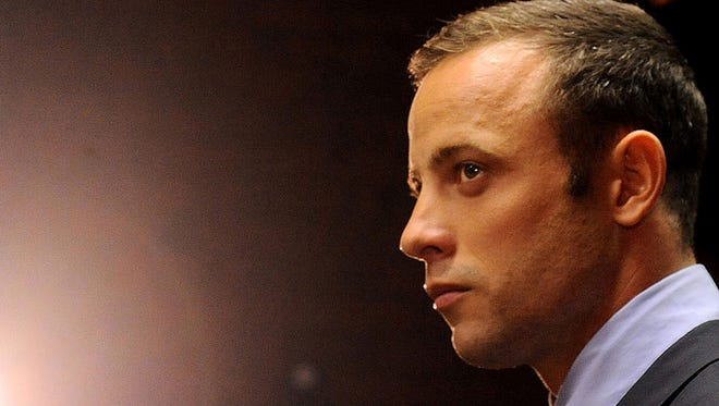Oscar Pistorius appears in court at a bail hearing Friday in Pretoria, South Africa. He has been charged with premeditated murder in  the shooting death of his girlfriend, Reeva Steenkamp.