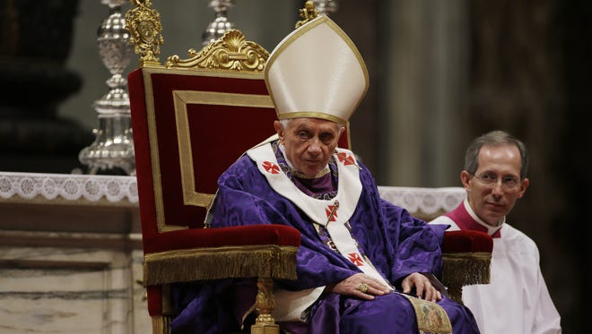 Pope Benedict XVI attends the celebration of Ash Wednesday mass in St. Peter's Basilica at the Vatican on Feb. 13.