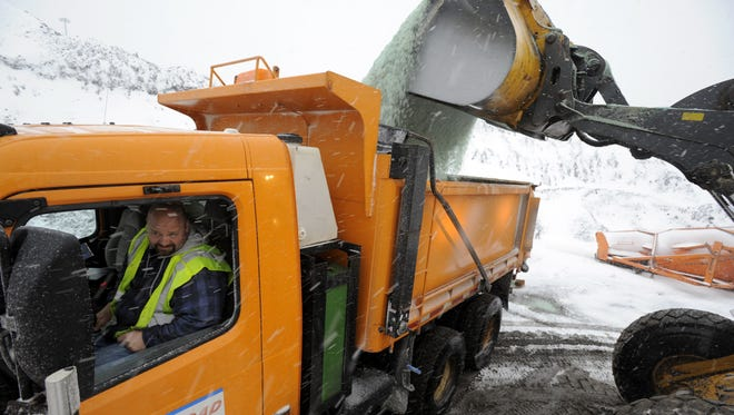 Driver Neil Simmons keeps an eye on the load as his trucks are loaded up with salt at the Oakland County Road Commission maintenance yard in Southfield, Mich.
