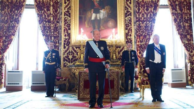 King Juan Carlos of Spain, center, receives new ambassadors at the Royal Palace on Feb. 6, 2013 in Madrid.