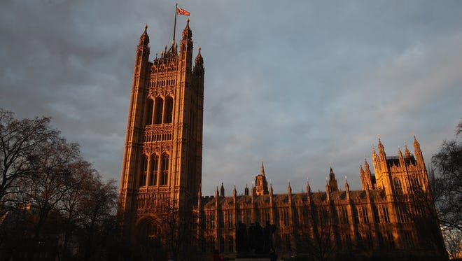 The sun sets on the Houses of Parliament in London.