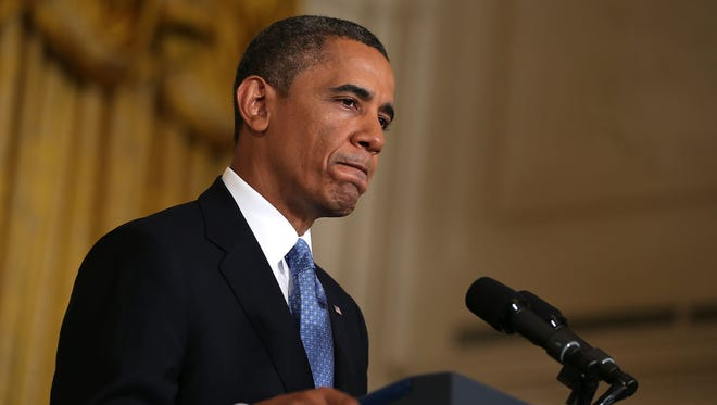President Barack Obama spoke on the debt ceiling and deficit reduction during the news conference January 14, 2013.