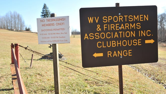 A sign guides visitors at the entrance to the West Virginia Sportsmen &  Firearms Association shooting range.