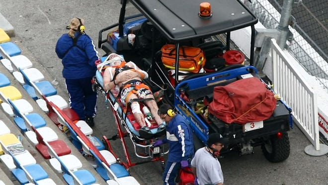 A fan is taken from the stands on a stretcher.