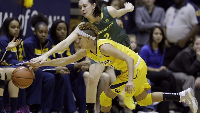 California guard Layshia Clarendon reaches for the ball under Oregon forward  Danielle Love. No. 6 Cal won 77-55.