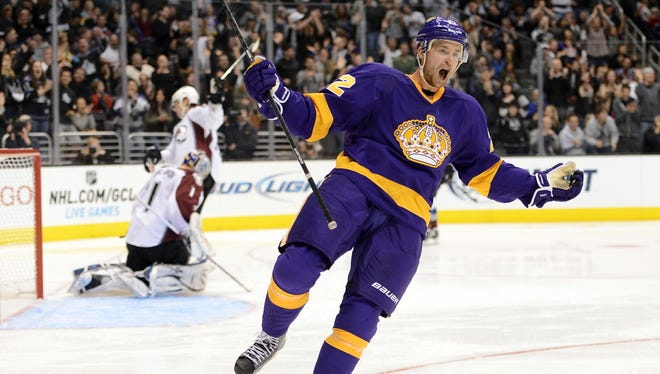 Trevor Lewis (22) of the Los Angeles Kings celebrates his second period short-handed goal, giving the Kings a 3-1 lead over the visiting Avalanche.  The Kings went on to win the game, 4-1.