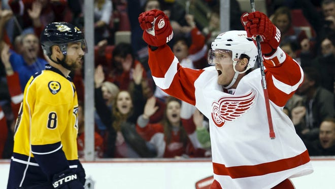 Red Wings right wing Daniel Cleary (11) celebrates his goal as Nashville Predators defenseman Kevin Klein (8) reacts in the third period at Joe Louis Arena. Detroit won 4-0.