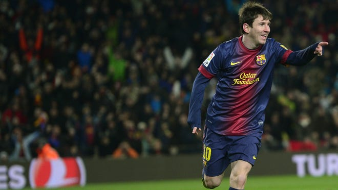 FC Barcelona's Lionel Messi, from Argentina, right, reacts after scoring against Sevilla during a Spanish La Liga soccer match.  Barcelona defeated Sevilla, 2-1.
