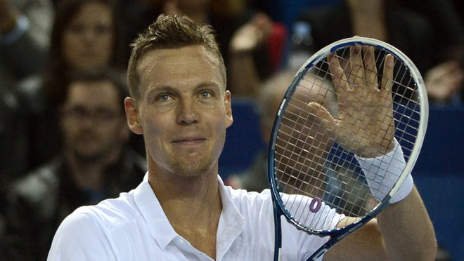 Tomas Berdych of the Czech Republic celebrates his victory against Dmitry Tursunov of Russia.