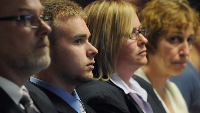 Sean Mulveyhill, second from left, sits in court during his hearing where he pleaded guilty to criminal harassment in the bullying case of Phoebe Prince.