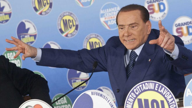 Media mogul and former Italian Premier Silvio Berlusconi gestures during a political rally in Rome on Wednesday.