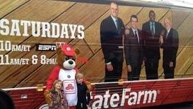 Fans pose for a picture with the State Farm mascot beside the ESPN 'College GameDay' bus outside of Buffalo Wild Wings in Middletown, K.Y.